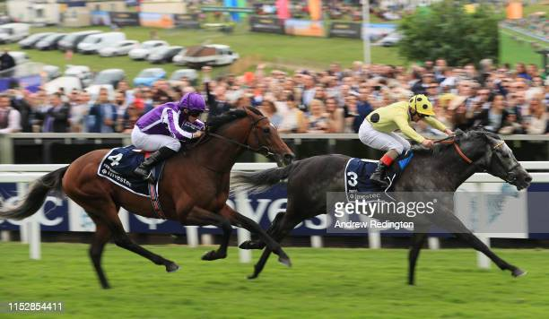 Andrea Atzeni rides Defoe to victory in the Investec Coronation Cup at Epsom Racecourse on May 31, 2019 in Epsom, England.