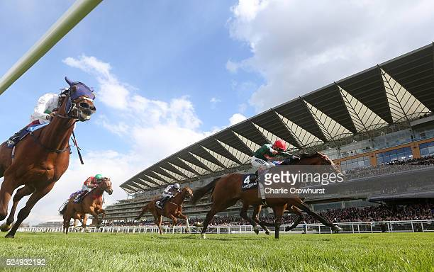 Andrea Atzeni rides Mizzou to win The Longines Sagaro Stakes at Ascot racecourse on April 27 2016 in Ascot England