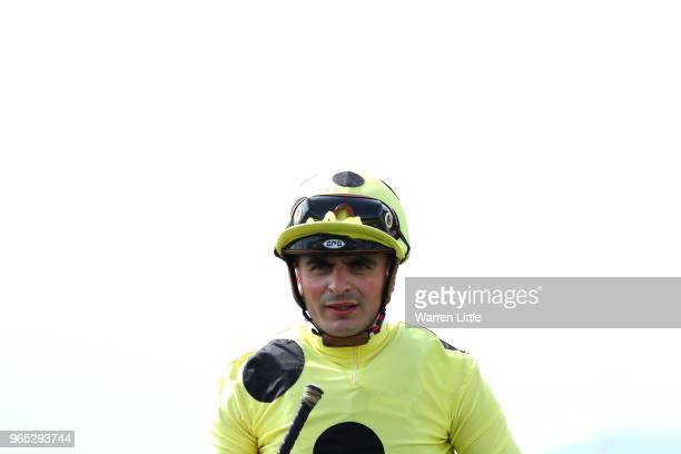 Andrea Atzeni riding Ajman King celebrates winning the Investec Wealth Investment Handicap during Ladies Day of the Investec Derby Festival at Epsom...