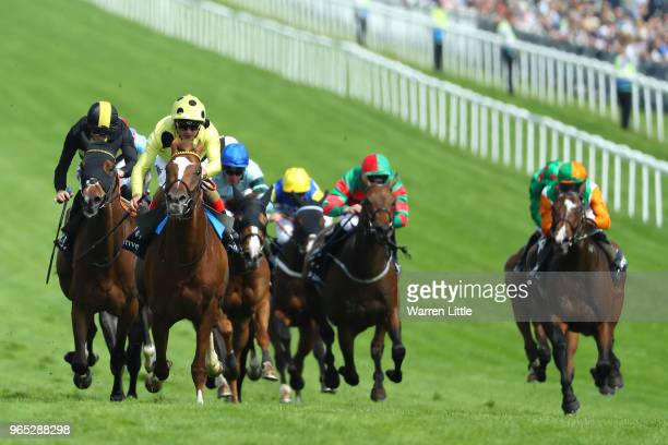 Andrea Atzeni riding Ajman King wins the Investec Wealth Investment Handicap from David Probert riding Brorocco during Ladies Day of the Investec...