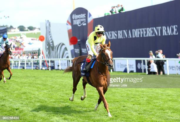 Andrea Atzeni riding Ajman King wins the Investec Wealth Investment Handicap during Ladies Day of the Investec Derby Festival at Epsom Downs on June...