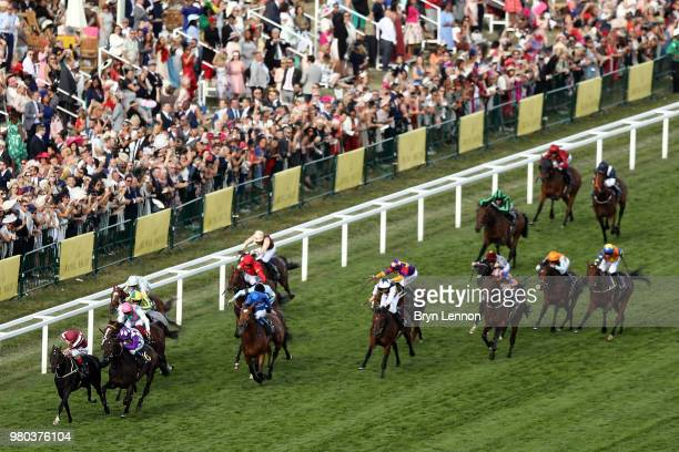 Andrea Atzeni riding Baghdad leads the pack on their way to winning The King George V Stakes on day 3 of Royal Ascot at Ascot Racecourse on June 21...