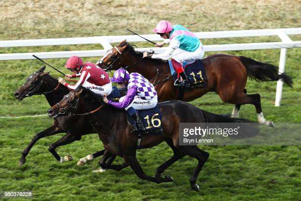 Andrea Atzeni riding Baghdad leads the race on his way to winning The King George V Stakes on day 3 of Royal Ascot at Ascot Racecourse on June 21...