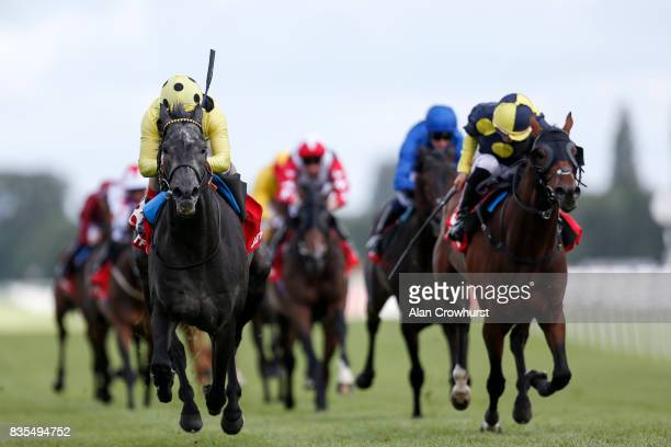 Andrea Atzeni riding Defoe win The Betfred Geoffrey Freer Stakes from Wall Of Fire at Newbury racecourse on August 19 2017 in Newbury England