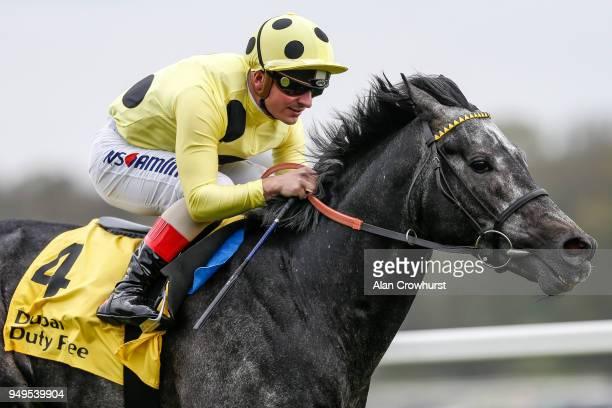 Andrea Atzeni riding Defoe win The Dubai Duty Free Finest Surprise Stakes at Newbury racecourse on April 21 2018 in Newbury England