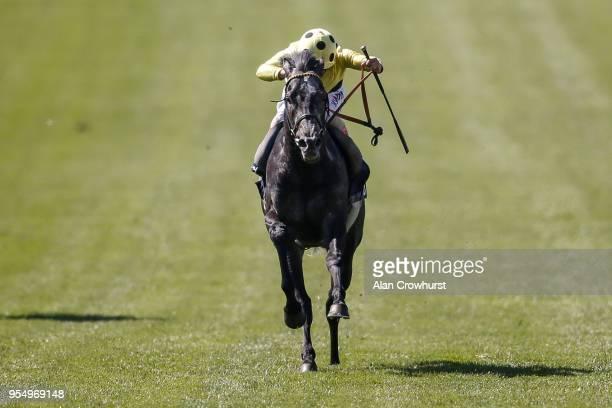 Andrea Atzeni riding Defoe win The Dunaden Jockey Club Stakes at Newmarket Racecourse on May 5 2018 in Newmarket United Kingdom