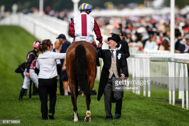 Andrea Atzeni riding Lagostovegas is met by connections after winning The Ascot Stakes on day 1 of Royal Ascot at Ascot Racecourse on June 19 2018 in...