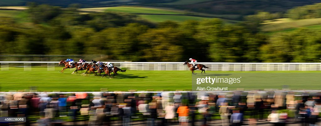 Andrea Atzeni riding Noble Gift (L) win The Gentrack Velocity Stakes at Goodwood racecourse on September 24, 2014 in Chichester, England.