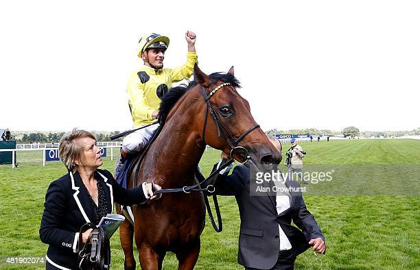 Andrea Atzeni riding Postponed celebrate winning The King George VI And Queen Elizabeth Stakes at Ascot racecourse on July 25 2015 in Ascot England