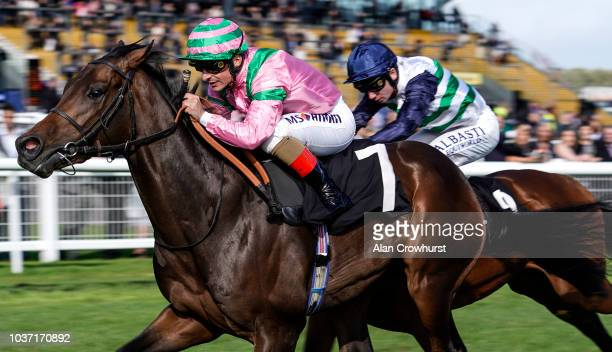 Andrea Atzeni riding Raakib Alhawa win The Haynes Hanson Clark Conditions Stakes at Newbury Racecourse on September 21 2018 in Newbury United Kingdom