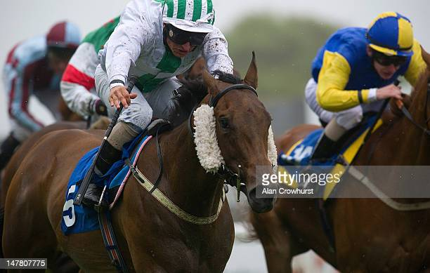 Andrea Atzeni riding Scommettitrice win The Hardings Catering Handicap Stakes at Brighton racecourse on July 03 2012 in Brighton England