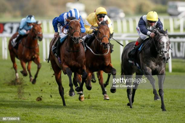 Andrea Atzeni riding Speak In Colours win The Bet Trough The Racing Post App Doncaster Stakes at Doncaster racecourse on October 28 2017 in Doncaster...