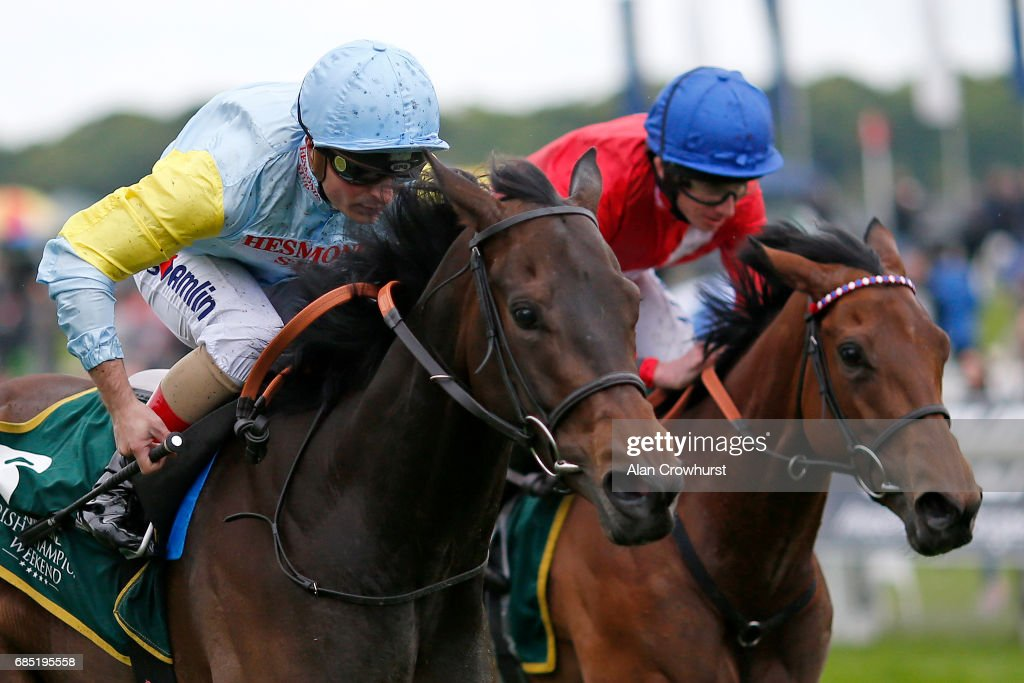 Andrea Atzeni riding Tomyris (L) win The Longines Irish Champions Weekend Fillies Stakes at York racecourse on May 19, 2017 in York, England.