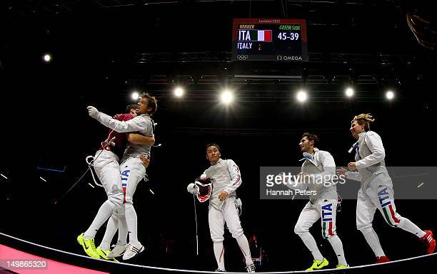 Andrea Baldini of Italy and his teammates celebrate defeating Yuki Ota of Japan to win the gold medal match 4539 in the Men's Foil Team Fencing...