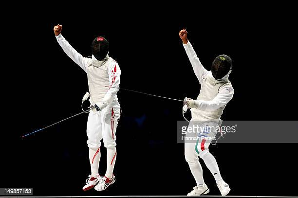 Andrea Baldini of Italy and Kenta Chida of Japan both react while competing in the gold medal match of the Men's Foil Team Fencing finals on Day 9 of...