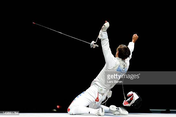 Andrea Baldini of Italy celebrates defeating Yuki Ota of Japan to win the gold medal match 4539 in the Men's Foil Team Fencing finals on Day 9 of the...
