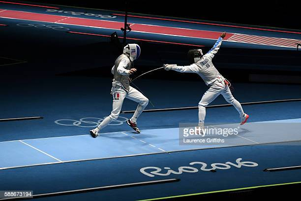 Andrea Baldini of Italy competes against Jeremy Cadot of France during a Men's Foil Team Semifinal bout on Day 7 of the Rio 2016 Olympic Games at...