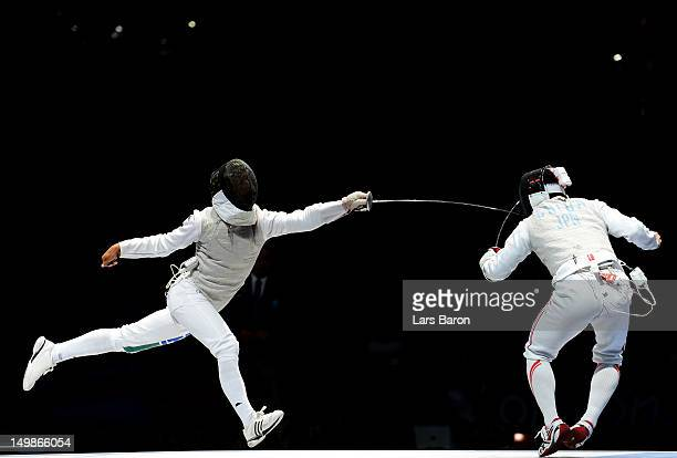 Andrea Baldini of Italy competes against Kenta Chida of Japan in the gold medal match of the Men's Foil Team Fencing finals on Day 9 of the London...
