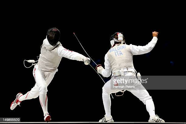 Andrea Baldini of Italy competes against Ryo Miyake of Japan in the gold medal match of the Men's Foil Team Fencing finals on Day 9 of the London...