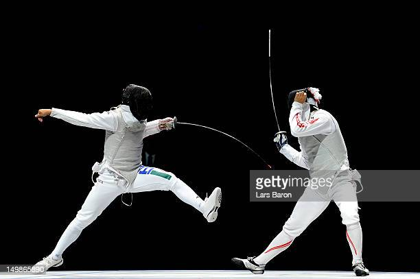 Andrea Baldini of Italy competes against Yuki Ota of Japan in the gold medal match of the Men's Foil Team Fencing finals on Day 9 of the London 2012...