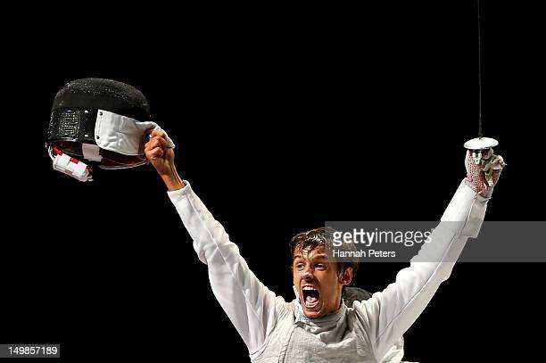 Andrea Baldini of Italy reacts while competing against Kenta Chida of Japan in the gold medal match of the Men's Foil Team Fencing finals on Day 9 of...