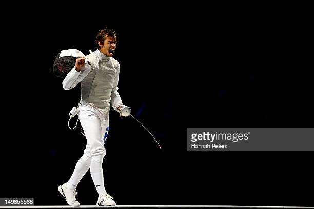 Andrea Baldini of Italy reacts while competing against Ryo Miyake of Japan in the gold medal match of the Men's Foil Team Fencing finals on Day 9 of...