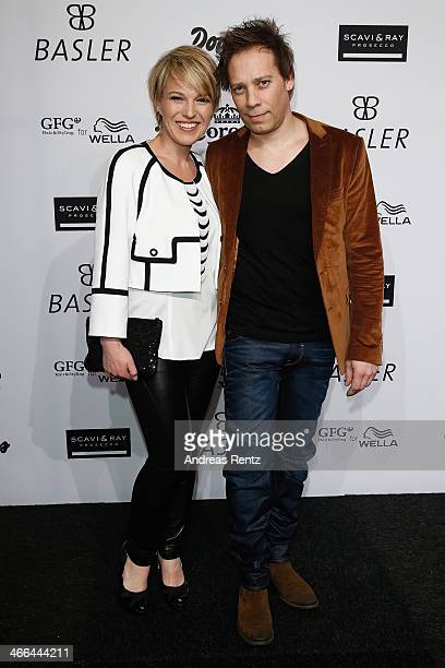 Andrea Ballschuh and Jem Atai attend the Basler fashion show on February 1 2014 in Dusseldorf Germany