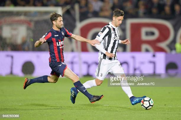 Andrea Barberis of Crotone battles for te ball with Rodrigo Bentancur of Juventus during the serie A match between FC Crotone and Juventus at Stadio...