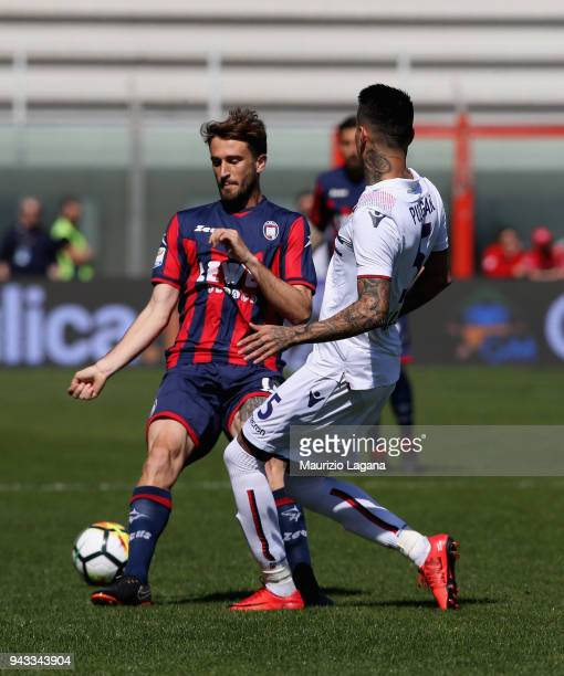 Andrea Barberis of Crotone competes for the ball with Erick Pulgar of Bologna during the serie A match between FC Crotone and Bologna FC at Stadio...