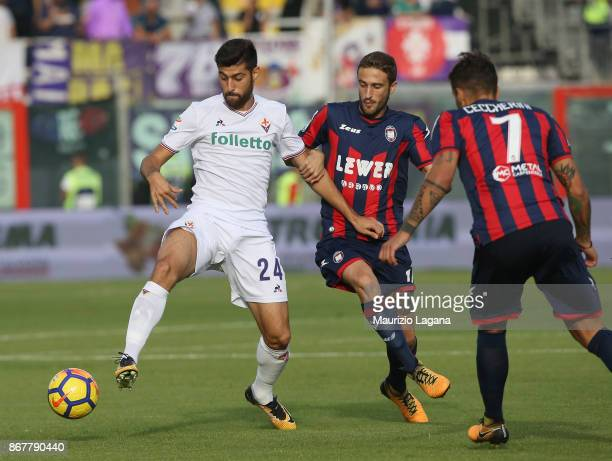 Andrea Barberis of Crotone competes for the ball with Marco Benassi of Fiorentina during the Serie A match between FC Crotone and ACF Fiorentina at...