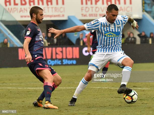Andrea Barberis of FC Crotone and Marco Borriello of Spal in action during the Serie A match between Spal and FC Crotone at Stadio Paolo Mazza on...