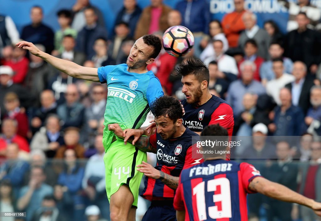 Andrea Bareberis (R) of Crotone competes for the ball with Ivan Perisic of Inter during the Serie A match between FC Crotone and FC Internazionale at Stadio Comunale Ezio Scida on April 9, 2017 in Crotone, Italy.
