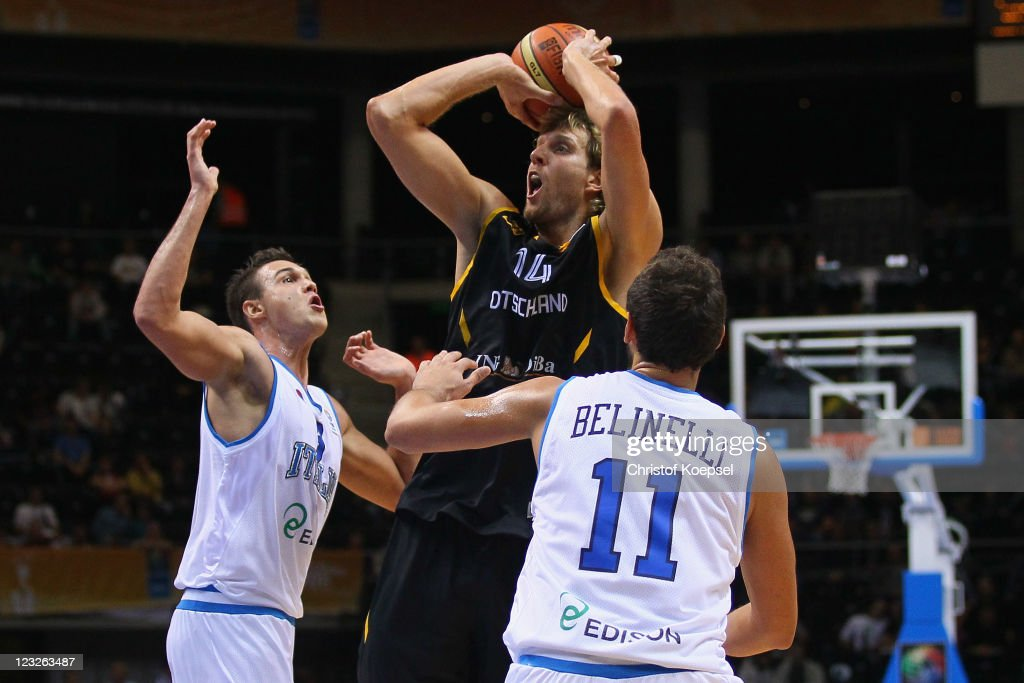 Andrea Bargnani (L) and Marco Belinelli (R) of Italy defend against Dirk Nowitzki (C) of Germany the EuroBasket 2011 first round group B match between Italy and Germany at Siauliai Arena on September September 1, 2011 in Siauliai, Lithuania.
