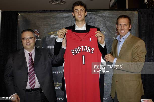 Andrea Bargnani and Team President and General Manager of the Toronto Raptors Bryan Colangelo pose for a portrait during a press conference at Air...