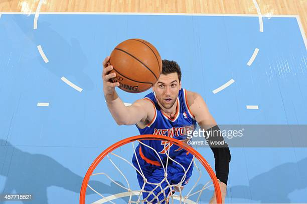 Andrea Bargnani of the New York Knicks drives to the basket against the Denver Nuggets on November 29 2013 at the Pepsi Center in Denver Colorado...