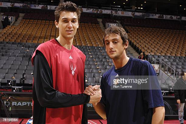 Andrea Bargnani of the Toronto Raptors and Marco Belinelli of the Golden State Warriors pose for a photo prior to their game at the Air Canada Centre...