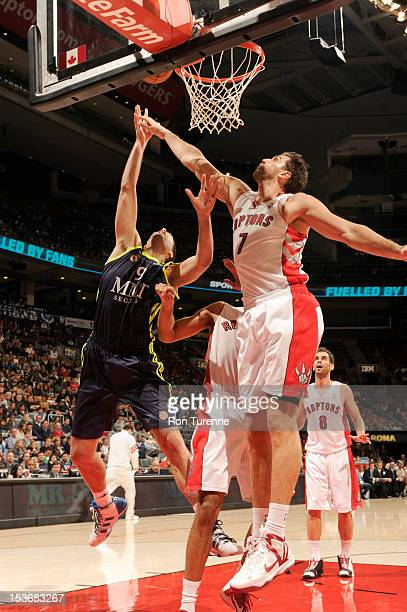 Andrea Bargnani of the Toronto Raptors defends against Felipe Reyes of the Real Madrid during the game between the Real Madrid and the Toronto...