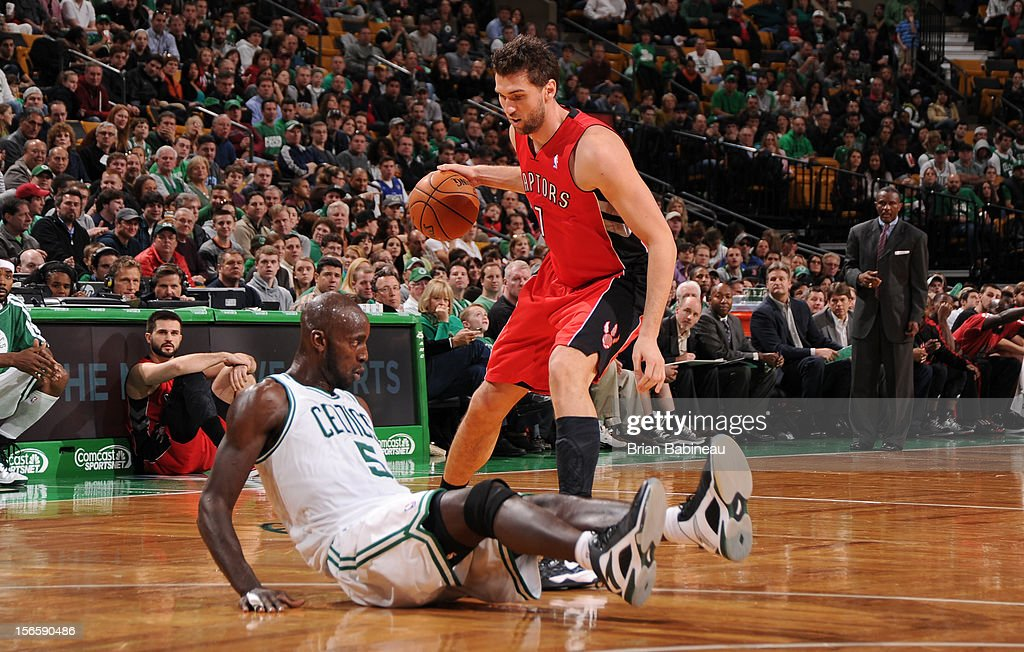 Andrea Bargnani #7 of the Toronto Raptors dribbles the ball while being defended by Kevin Garnett #5 of the Boston Celtics on November 17, 2012 at the TD Garden in Boston, Massachusetts.