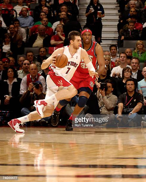 Andrea Bargnani of the Toronto Raptors drives around Jason Collins of the New Jersey Nets in Game Five of the Eastern Conference Quarterfinals during...