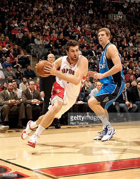 Andrea Bargnani of the Toronto Raptors drives baseline past defender Dirk Nowitzki of the Dallas Mavericks during a game on January 17 2010 at the...