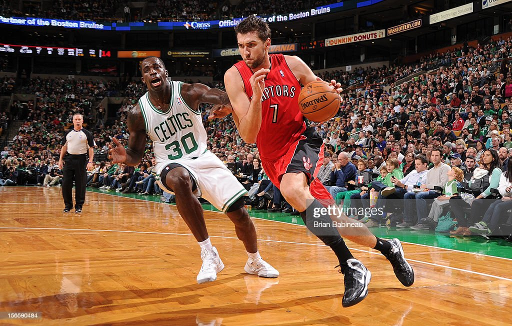 Andrea Bargnani #7 of the Toronto Raptors drives to the basket against Brandon Bass #30 of the Boston Celtics on November 17, 2012 at the TD Garden in Boston, Massachusetts.