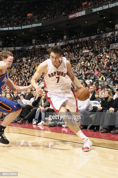 Andrea Bargnani of the Toronto Raptors drives to the basket against David Lee of the New York Knicks during the game at the Air Canada Centre on...
