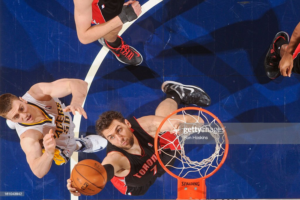 Andrea Bargnani #7 of the Toronto Raptors grabs a rebound against Tyler Hansbrough #50 of the Indiana Pacers on February 8, 2013 at Bankers Life Fieldhouse in Indianapolis, Indiana.