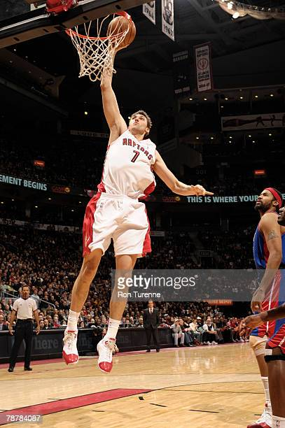 Andrea Bargnani of the Toronto Raptors makes a layup inside past Rasheed Wallace of the Detroit Pistons at the Air Canada Centre January 4 2008 in...