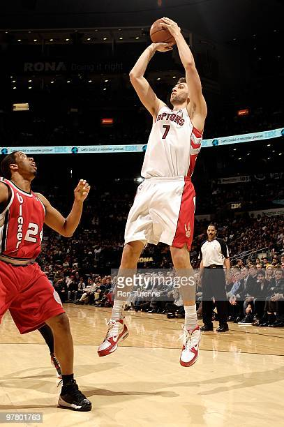 Andrea Bargnani of the Toronto Raptors shoots against Andre Miller of the Portland Trail Blazers during the game on February 24 2010 at Air Canada...