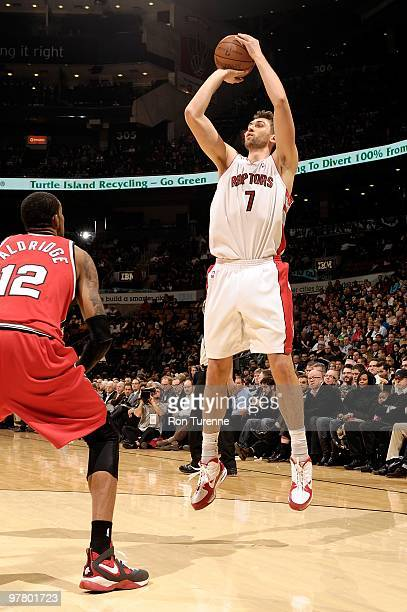 Andrea Bargnani of the Toronto Raptors shoots against LaMarcus Aldridge of the Portland Trail Blazers during the game on February 24 2010 at Air...