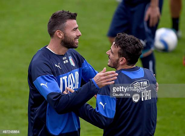 Andrea Barzagli and Alessandro Florenzi chat during the Italy training session at Coverciano on November 15 2015 in Florence Italy