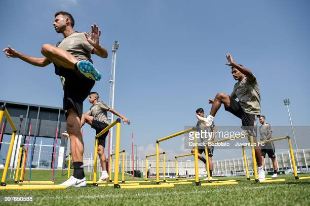 Andrea Barzagli and Alex Sandro during a Juventus training session at Juventus Training Center on July 13 2018 in Turin Italy