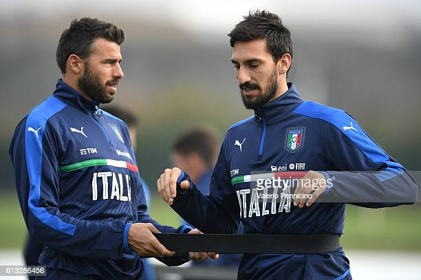 Andrea Barzagli and Davide Astori of Italy warm up during an Italy training session at Juventus Center Vinovo on October 8 2016 in Vinovo Italy