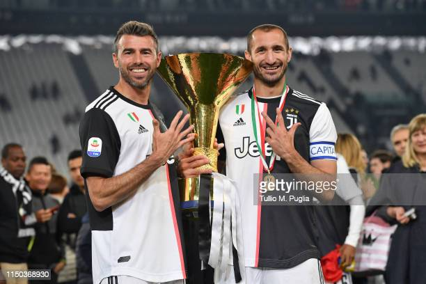 Andrea Barzagli and Giorgio Chiellini of Juventus celebrate during the awards ceremony after winning the Serie A Championship during the Serie A...